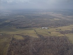 Aerial view of the wooded, hilly topography of Jefferson Township