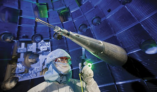 Engineers, scientists and technicians at work on target positioner inside National Ignition Facility (NIF) target chamber Worker inside the target chamber of the National Ignition Facility.jpg