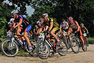 Cross-country cycling - A cross-country mountain biking race.