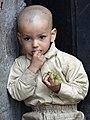 Young Boy in Doorway - Varanasi - Uttar Pradesh - India (12498944804).jpg