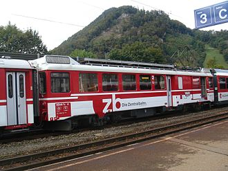 Luzern–Stans–Engelberg railway line - Train in Stansstad station with the Lopperberg in the background.