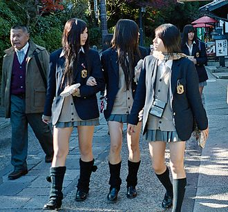 Japanese school uniform - Kogal culture: Japanese schoolgirls wearing short skirts and loose socks