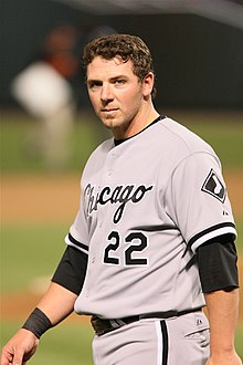 Josh Fields, standing, looking at the camera, wearing number 22 for the Chicago White Sox.