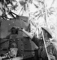 013955 Australian infantryman getting grenades Buna.jpg