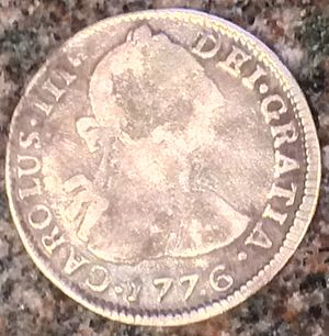"Three-cent silver - A Spanish colonial two-reals piece (""two bits"") from the Potosí Mint (today in Bolivia)"