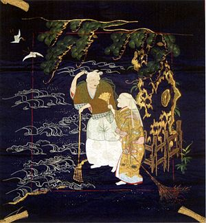 Fukusa - 19th century Fukusa portraying Jô and Uba in a scene from the noh play Takasago; embroidered silk and couched gold-wrapped thread on indigo dyed shusa satin silk