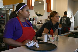 Waitresses at the counter at Elmo's Diner in D...