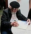 2011-03-28 Ernesto Cardenal autographing at Akkonplatz church, Vienna.jpg