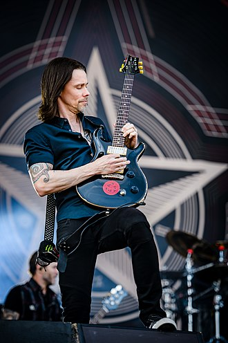 Myles Kennedy - Kennedy playing guitar with Alter Bridge in 2017