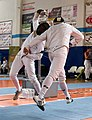 2nd Leonidas Pirgos Fencing Tournament. Fierce struggle in the air between two unidentified fencers.jpg