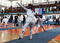2nd Leonidas Pirgos Fencing Tournament. The fencer Giorgos Alvanos performs a counter-attack and scores a touch.jpg