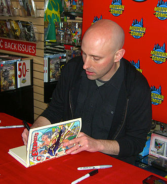 Escapist (character) - Writer Brian K. Vaughan signing a copy of the comics adaptation at Midtown Comics in Manhattan
