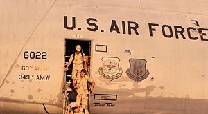 60th Operations Group - Personnel from the 366th Air Expeditionary Wing arriving in Lockheed C-5B Galaxy 86-022 at an operating location in support of the U.S. Central Command execution of Operation Enduring Freedom.