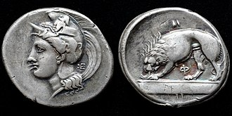 History of lions in Europe - Silver stater struck in Velia 334-300 BC depicting Athena wearing a Phrygian helmet decorated with a centaur and lion devouring prey