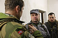 A Norwegian soldier, left, discusses staff operations with Ukrainian soldiers acting as Afghan National Police officers during a military adviser team (MAT) and police adviser team (PAT) training exercise at 131210-A-RJ750-026.jpg