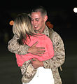 A U.S. Marine with Marine All-Weather Fighter Attack Squadron 224 hugs a loved one after a six-month deployment to the Western Pacific in Support of the Unit Deployment Program aboard Marine Corps Air Station 130322-M-EK666-004.jpg