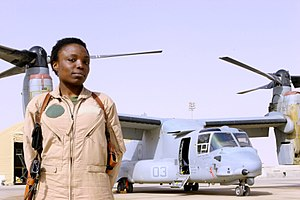 Women in the United States Marines - Captain Elizabeth A. Okoreeh-Baah, the first female MV-22 Osprey pilot, stands on the flight line in Al Asad, Iraq after a combat operation on March 12, 2008.