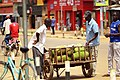 A man selling jackfruit along the road in Lira, Uganda.jpg