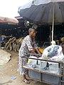 A woman selling food.jpg