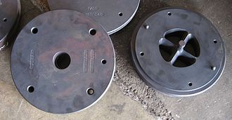 Extrusion - Two-piece aluminum extrusion die set (parts shown separated.) The male part (at right) is for forming the internal cavity in the resulting round tube extrusion.