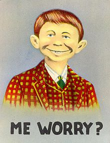 "Color poster illustration of a boy with a goofy grin, captioned ""Me Worry?"""