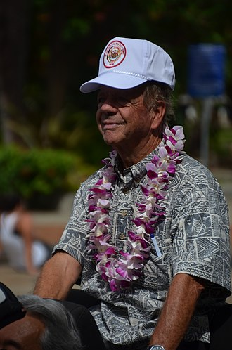 Aloha shirt - Man with a typical Aloha shirt during the Aloha Festivals Floral Parade 2012