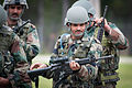 An Indian Army paratrooper with the 50th Independent Para Brigade examines an M4 carbine prior to sighting in the weapon at Fort Bragg, N.C..jpg
