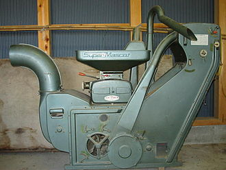 Rice huller - An old-type mechanical huller, driven by a gasoline engine