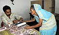 An old woman voter being administered indelible ink, at a polling booth, during the 5th Phase of General Elections-2014, at Patna Sahib, Bihar on April 17, 2014.jpg
