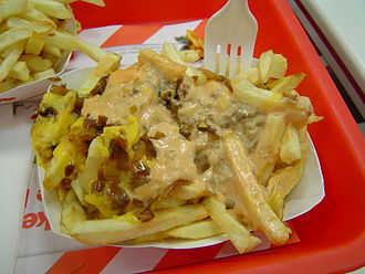 "Cheese fries - 'Animal Fries' consisting of cheese, grilled onions, and spread on a regular order of fries at In-N-Out Burger, part of their ""secret"" menu"