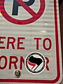Antifa sticker on No Parking sign.jpg