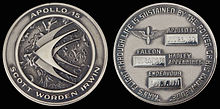 "Both sides of a silver ""Robbins"" medallion with the mission logo and dates of travel"