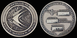 Apollo 15 mission emblem and crew names (front). Dates (launch, lunar landing, and return) and landing site (back)
