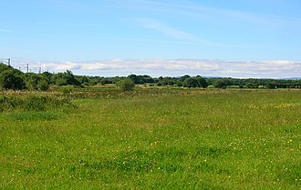 Ardeer, North Ayrshire - The old sea channel and coastline with Ardeer to the left.