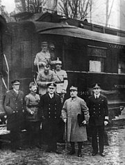 This photograph was taken after reaching an agreement for the armistice that ended World War I. The location is in the forest of Compiègne. Foch is second from the right. The train carriage seen in the background, where the armistice was signed, later became the setting of France's own armistice in June 1940. The rail car was ultimately destroyed at Berlin when the Allies bombed that city.
