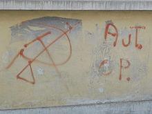 Scritta comparsa sui muri di Torino nel 1977