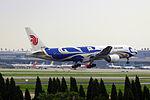 B-2059 - Air China - Boeing 777-2J6 - Blue Phoenix Livery - SHA (14233531429).jpg