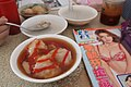 Bawan with sauce at table in a restaurant somewhere in Youchang.jpg