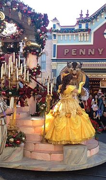 beauty and the beast in the christmas ball unit of a christmas fantasy parade at disneyland