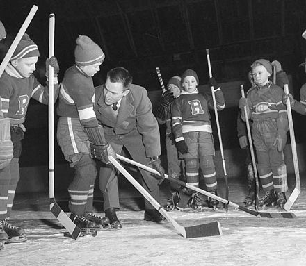 Youths being taught how to properly deliver a check in ice hockey Body checking lesson.jpg