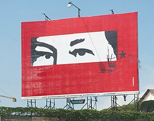 Bolivarian propaganda - A billboard of Hugo Chávez's eyes and signature in Guarenas, Venezuela.