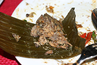 Entomophagy - Indonesian botok tawon, spiced bee larvae steamed in banana leaf package.