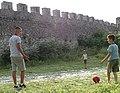Boys Playing Football by Castle Walls - Berat - Albania (28625814658).jpg