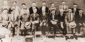 International Labor Defense - Party leaders jailed in connection with the August 1922 raid on the CPA's Bridgman Convention. Executive Secretary C.E. Ruthenberg is seated in the front row in the middle. The Labor Defense Council was established to defend the individuals arrested in this raid.