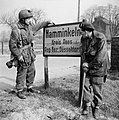 British airborne troops study a sign outside Hamminkeln during operations east of the Rhine, 25 March 1945. BU2292.jpg