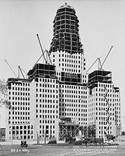 Cranes working on a small skyscraper