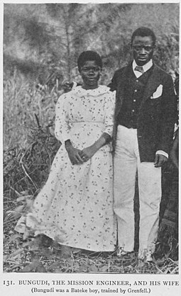 1908 photograph of a married Christian couple. Bugidi, the mission engineer, and his wife. Bakundi was a Bateke boy, trained by Grenfell.jpg