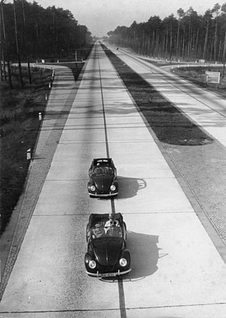 Reichsautobahn - Autobahn view with two Volkswagens: propaganda photo celebrating 10 years of Nazi achievements, January 1943