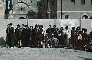 Porajmos - Romani civilians in Asperg, Germany are rounded up for deportation by German authorities on 22 May 1940.