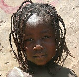 English: Young girl on a market in Ouagadougou...